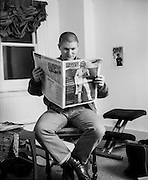 George Marshal reading 'Skinhead Times' in Gav's Flat, Talbot Road, Highgate, UK, 1980s.