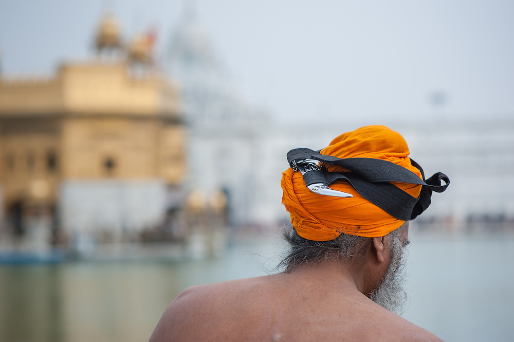 Sikh man with kirpan on turban at Golden Temple in Amritsar (India)