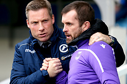 Stoke City manager Nathan Jones (right) and Millwall manager Neil Harris shake hands prior to the beginning of the match
