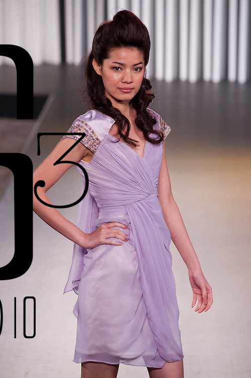 HONG KONG - JULY 06:  A model displays a creation of Benten during the 'Lady Macaroon' show as part of the Hong Kong Fashion Week Spring/Summer 2011 at the Hong Kong Convention and Exhibition Center on July 6, 2010 in Hong Kong, China.  Photo by Victor Fraile / studioEAST