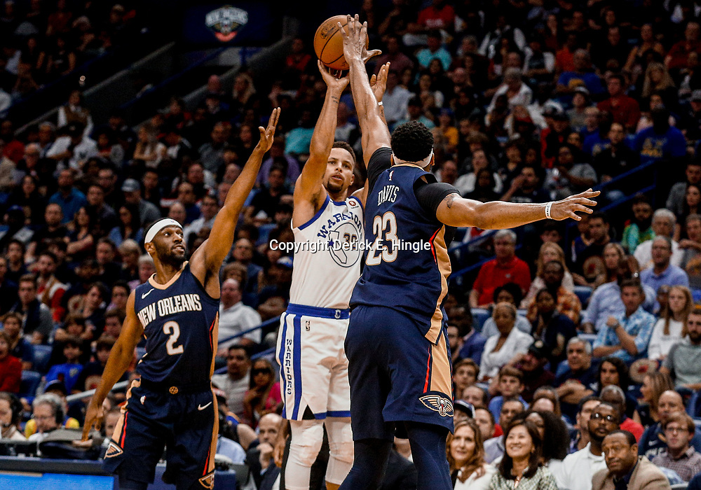 Oct 20, 2017; New Orleans, LA, USA; Golden State Warriors guard Stephen Curry (30) shoots over New Orleans Pelicans forward Anthony Davis (23) and guard Ian Clark (2) during the first quarter of a game at the Smoothie King Center. Mandatory Credit: Derick E. Hingle-USA TODAY Sports
