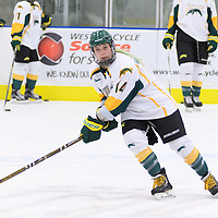 4th year defender Nikki Watters-Matthes (14) of the Regina Cougars in action during the Women's Hockey Home Game on October 14 at Co-operators arena. Credit: Arthur Ward/Arthur Images