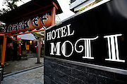 A love hotel is located next to a Shinto shrine in the Dogenzaka entertainment district -- sometimes referred to as Love Hotel Hill -- of Tokyo, Japan on Sunday 19 April  2009. .Photographer: Robert Gilhooly