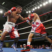 "Samuel Rodriguez (left) fights Jayron Santiago during a ""Boxeo Telemundo""  boxing match at the Kissimmee Civic Center on Friday, July 18, 2014 in Kissimmee, Florida. Rodriguez won the bout. (AP Photo/Alex Menendez)"