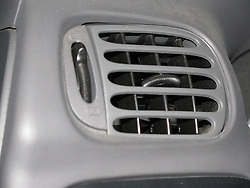 08 July 2014:   drivers area of a 2003 Ford F150 pick up truck.  Radio, steering wheel, hvac vent