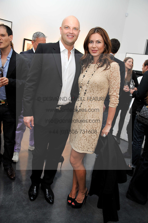 RUSLAN & KATYA FOMICHEV at a private view of photographs by Herb Ritts held at Hamiltons Gallery, 13 Carlos Place, London on 21st June 2011.