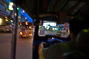 "29 JUNE 2011 - CHIANG MAI, THAILAND: Riding in a ""tuk-tuk"" or three wheeled taxi, in Chiang Mai, Thailand. Tuk-tuks are common throughout Asia. They are called tuk-tuk because of the distinctive sound their two-stroke motors make. PHOTO BY JACK KURTZ"