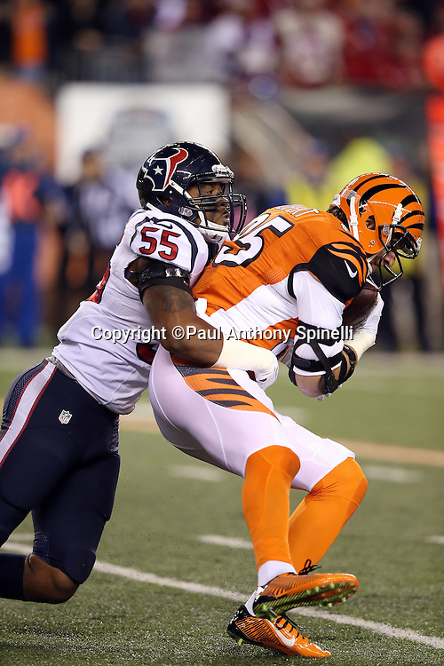 Cincinnati Bengals tight end Tyler Eifert (85) gets tackled by Houston Texans inside linebacker Benardrick McKinney (55) as he catches a 14 yard pass for a first down at the Texans 14 yard line in the first quarter during the 2015 week 10 regular season NFL football game against the Houston Texans on Monday, Nov. 16, 2015 in Cincinnati. The Texans won the game 10-6. (©Paul Anthony Spinelli)