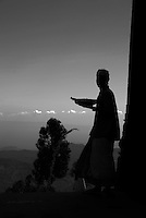 Black and white photo of our friend Nyoman looking out over the temple steps.