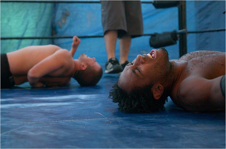"Michael Stenerson / Staff Photographer.J Fury ""The Blessing"", right, and Markus Riot both writhe in pain during their wrestling match. High Risk Wrestling is a Christian group that has been promoting wrestling events for about a year here in the High Desert."
