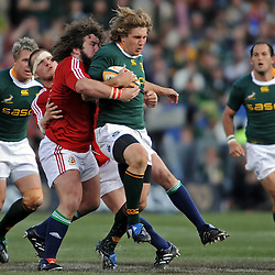 Frans Steyn of the Springboks is tackled by Gethin Jenkins and Adam Jones of the British and Irish Lions during the British and Irish Lions tour 2009