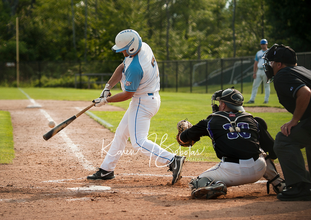 Vinny Zarrillo connects for a two run homer during Tuesday night's opening game of a double header with the Keene Swamp Bats.  (Karen Bobotas/for the Laconia Daily Sun)