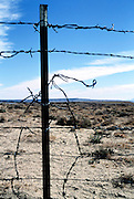 broken barbed wire fence New Mexico USA