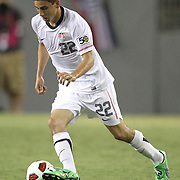 USA midfielder Alejandro Bedoya (22) dribbles the ball during a CONCACAF Gold Cup soccer match between the United States and Panama on Saturday, June 11, 2011, at Raymond James Stadium in Tampa, Fla. (AP Photo/Alex Menendez)