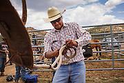 14 JULY 2012 - OAK SPRINGS, AZ:  A bull riding student cleans his rigging after a bull riding class in the Aspen Canyon Rodeo Club arena in Oak Springs, AZ. The bull riding class was offered by the Crooked Horn Cattle Co. in the community of Oak Springs on the Navajo Nation, about 15 miles south of Window Rock, AZ. Eleven cowboys signed up for bull riding classes and one signed up for bull fighting classes. The bull riding class started with lessons on a mechanical bucking machine before the cowboys rode bulls.    PHOTO BY JACK KURTZ