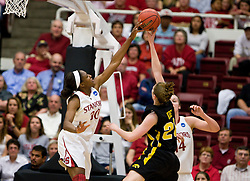 March 22, 2010; Stanford, CA, USA;  Stanford Cardinal forward Nnemkadi Ogwumike (30) blocks a shot from Iowa Hawkeyes forward Kelly Krei (20) during the first half in the second round of the 2010 NCAA womens basketball tournament at Maples Pavilion. Stanford defeated Iowa 96-67.