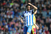 Brighton central defender, Connor Goldson (17) holds his head in his hands during the Sky Bet Championship match between Brighton and Hove Albion and Burnley at the American Express Community Stadium, Brighton and Hove, England on 2 April 2016.