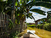 30 SEPTEMBER 2016 - SAI NOI, AYUTTHAYA, THAILAND:  A boat on a flooded street in Sai Noi. The Chao Phraya River, the largest river that runs through central Thailand, has hit flood stage in several areas in Ayutthaya and Ang Thong provinces. Villages along the river are flooded and farms are losing their crops due to the flood. This is the same area that was devastated by floods in 2011, but the floods this year are not expected to be as severe. The floods are being fed by water released from upstream dams. The water is being released to make room for heavy rains expected in October.     PHOTO BY JACK KURTZ