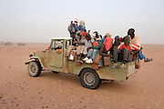 Pick-up in the Ténéré desert full with African migrants going to the Libyan border.