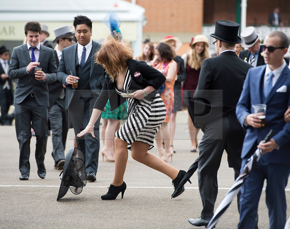 © London News Pictures. 22/06/2013. Ascot, UK.  A Racegoer loses her hat in strong winds on day 5 of Royal Ascot at Ascot racecourse in Berkshire, on June 20, 2013.  The 5 day showcase event,  which is one of the highlights of the racing calendar, has been held at the famous Berkshire course since 1711. Photo credit should read: Ben Cawthra/LNP