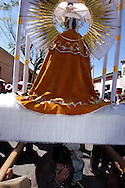 """Bolivia. Tarija. Festa di San Roque.At the end of each station stop those who have let themselves be organized """"fly"""" by the saint, a sign of submission and faith."""