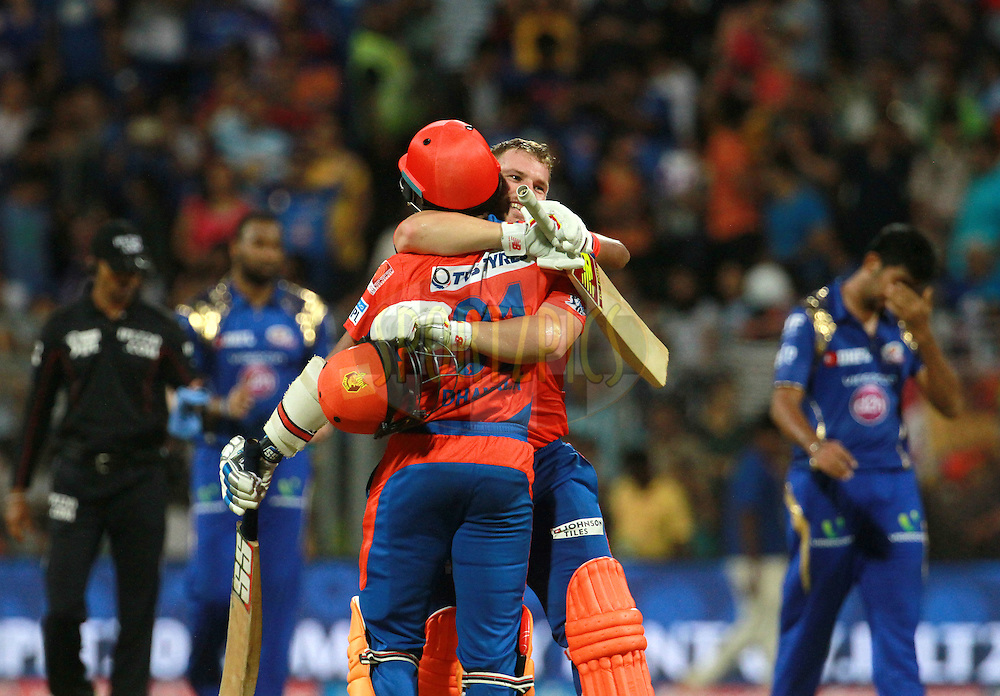 Gujarat Lions player Dhawal Kulkarni and Gujarat Lions player Aaron Finch celebrates after winning the match 9 of the Vivo Indian Premier League ( IPL ) 2016 between the Mumbai Indians and the Gujarat Lions held at the Wankhede Stadium in Mumbai on the 16th April 2016<br /> <br /> Photo by Vipin Pawar/ IPL/ SPORTZPICS