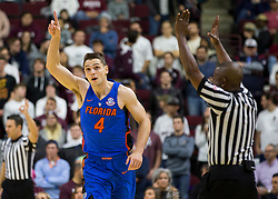 Florida guard Egor Koulechov (4) reacts after making a three point basket against Texas A&M during the first half of an NCAA college basketball game Tuesday, Jan. 2, 2018, in College Station, Texas. (AP Photo/Sam Craft)