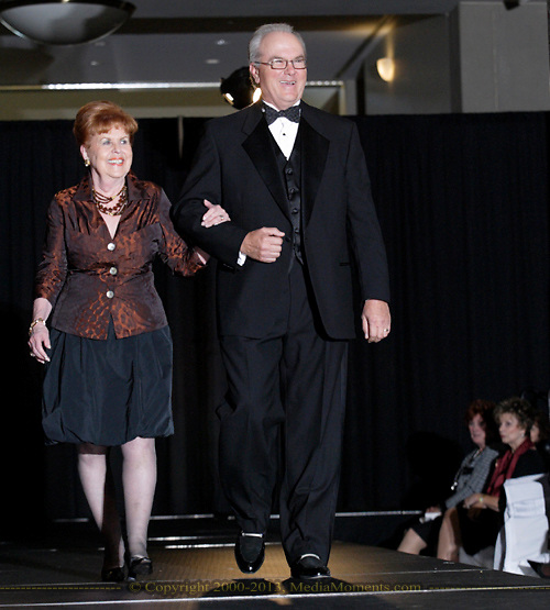 Community role models Toni Winger (left) and Fred Manchur on the runway during the 23rd Annual Bravo! Fashion Show at the Sinclair Conference Center in downtown Dayton, Friday, October 1, 2010.