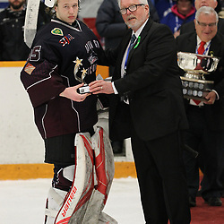 DRYDEN, ON - MAY 5: Executive Ted Magee of the Northern Ontario Junior Hockey League presents the Dudley-Hewitt Cup Top Goaltender award to Landon Pavlisin #35 of the Dryden GM Ice Dogs . Game Eight - Championship of the Central Canadian Junior Championship during the 2018 Dudley Hewitt Cup on May 5, 2018 at the Dryden Memorial Arena in Dryden, Ontario, Canada. (Photo by Tim Bates/DHC via OJHL Images)