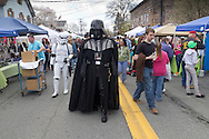 Pine Bush, New York - A man dressed as Darth Vader walks down Main Street during the Pine Bush UFO Fair on  on April 26, 2014.