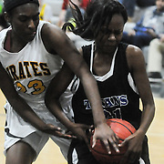 Topsail's Brandy Williams and Trask's Qua Schaffer struggle for a loose ball Friday December 5, 2014 at Topsail High School in Hampstead, N.C. (Jason A. Frizzelle)