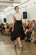 Dip hem dress in black and white. By Carmen Marc Valvo at the Spring 2013 Fashion Week show in New York.