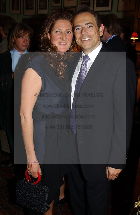 KATHERINE IRELAND and DAVID ARNOLD publisher of House Beautiful at a party for interior designer Katherine Ireland held at Marks club, 46 Charles Street, London W1 on 27th September 2004.<br /><br />NON EXCLUSIVE - WORLD RIGHTS