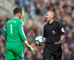 Referee Mike Dean talks to Thomas Heaton of Burnley after overturning a penalty decision - Mandatory by-line: Jack Phillips/JMP - 13/04/2019 - FOOTBALL - Turf Moor - Burnley, England - Burnley v Cardiff City - English Premier League