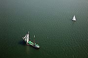 Nederland, Noord-Holland, Waterland, 28-04-2010; Zeilschip (charter) en zeiljacht gaan overstag op het Markermeer, ter hoogte van Uitdam..Sailboat is tacked on  inner sea IJsselmeer, near Uitdam.luchtfoto (toeslag), aerial photo (additional fee required).foto/photo Siebe Swart