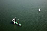 Nederland, Noord-Holland, Waterland, 28-04-2010; Zeilschip (charter) en zeiljacht gaan overstag op het Markermeer, ter hoogte van Uitdam..Sailboat is tacked on  inner sea IJsselmeer, near Uitdam.luchtfoto (toeslag), aerial photo (additional fee required).foto/photo Siebe Swart