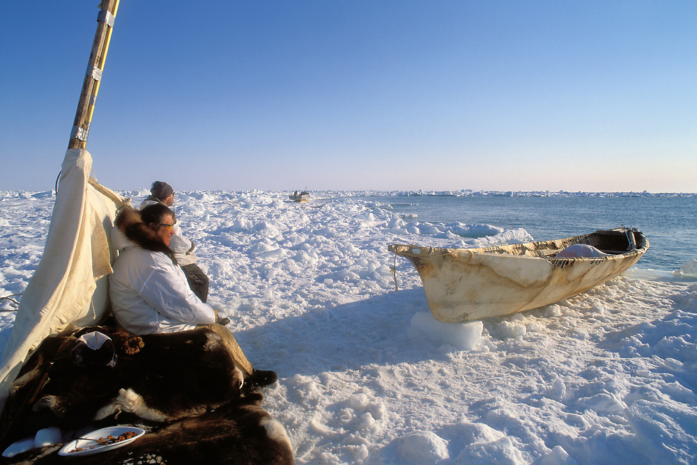 Barrow, Alaska, Native whaling crew waiting at the edge of the icepack for a sighting of a bowhead whale