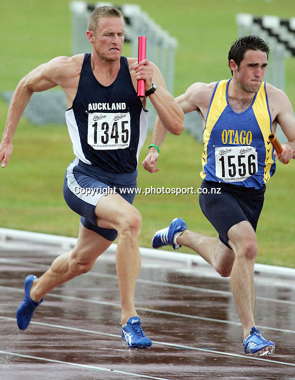 James Mortimer (Auckland) races against Todd Mansfield (Otago) in the Men's 4 x 100m relay at the 2007 Union Athletics New Zealand Track &amp; Field Championships at TET Stadium, Inglewood, New Zealand on Saturday 3 March 2007. Photo: Hannah Johnston/PHOTOSPORT<br /> <br /> <br /> <br /> 030307