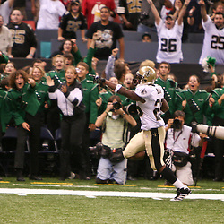 Oct. 8, 2006; New Orleans, LA, USA; New Orleans Saints running back (25) Reggie Bush celebrates as he runs back a 65-yard punt return against the Tampa Bay Buccaneers during the fourth quarter at the Louisiana Superdome in New Orleans, LA. The touchdown return was the first score in Bush's NFL career. Mandatory Credit: Derick E. Hingle