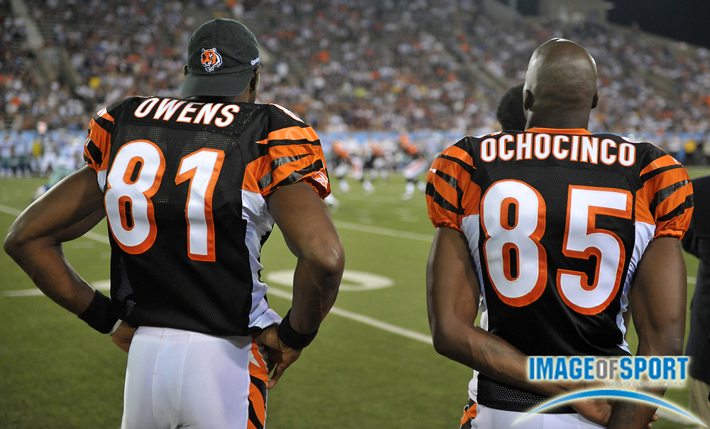 Aug 8, 2010; Canton, OH, USA; Cincinnati Bengals receivers Terrell Owens (81), left, and Chad Ochocinco (85) watch on the sidelines during the fourth quarter of a preseason game against the Dallas Cowboys at Fawcett Stadium. Photo by Image of Sport