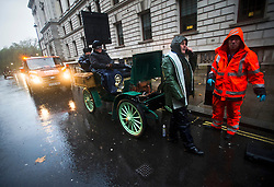 © London News Pictures. 04/11/2012. London, UK.  An RAC vehicle repair man attending to a broken down car during the 2012 London to Brighton Veteran Car Run on November 4, 2012.  Over 500 vehicles built before 1905 take part in the annual run which attracts competitors from all over the world. Photo credit: Ben Cawthra/LNP.