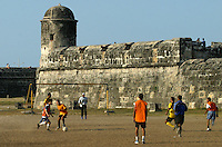 """A group plays soccer outside the Spanish fort walls that surround the """"Old City"""" in Cartagena, on Colombia's Caribbean coast. (Photo/Scott Dalton)"""