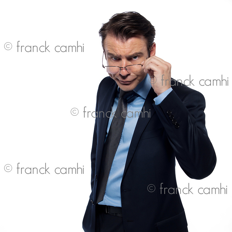 man businessman attentive holding glasses isolated studio on white background