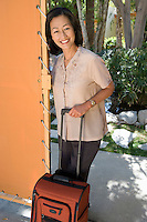 Woman with luggage on vacation, portrait