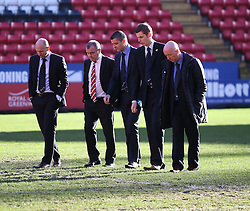 Referee Iain Williamson, his assistants and Charlton Athletic ex-player and football adviser Keith Peacock discuss the state of the pitch - Photo mandatory by-line: Robin White/JMP - Tel: Mobile: 07966 386802 11/01/2014 - SPORT - FOOTBALL - The Valley - Charlton - Charlton Athletic v Barnsley - Sky Bet Championship