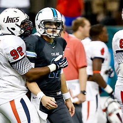 Sep 7, 2013; New Orleans, LA, USA; Tulane Green Wave quarterback Nick Montana (11) and South Alabama Jaguars defensive lineman Montavious Williams (92) following a failed two point conversion that would have tied the game during the fourth quarter of a game against the South Alabama Jaguars at the Mercedes-Benz Superdome. South Alabama defeated Tulane 41-39. Mandatory Credit: Derick E. Hingle-USA TODAY Sports