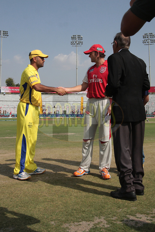 MS Dhoni and Adam Gilchrist shake hand during match 9 of the Indian Premier League ( IPL ) Season 4 between the Kings XI Punjab and the Chennai Super Kings held at the PCA stadium in Mohali, Chandigarh, India on the 13th April 2011..Photo by Anil Dayal/BCCI/SPORTZPICS
