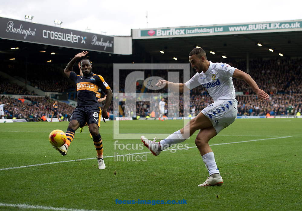Kemar Roofe of Leeds United (right) crosses as Vurnon Anita of Newcastle United closes down during the Sky Bet Championship match at Elland Road, Leeds<br /> Picture by Russell Hart/Focus Images Ltd 07791 688 420<br /> 20/11/2016