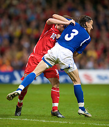 CARDIFF, WALES - Friday, September 5, 2008: Wales' Ched Evans clashes with Azerbaijan's Sasha during the opening 2010 FIFA World Cup South Africa Qualifying Group 4 match at the Millennium Stadium. (Photo by David Rawcliffe/Propaganda)
