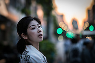 JAPAN, Tokyo : local woman waits for the portable shrine or &quot;mikoshi&quot; during the Sanja Matsuri festival in Tokyo on May 15, 2016.<br /> Over 1.5 million people flocked to Tokyo's Asakusa district during the three-day-long annual festival, which heralds the coming of summer in the Japanese capital.